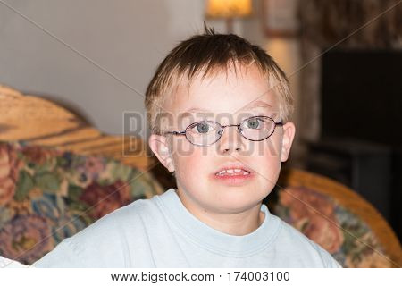 Headshot of Cute Little Boy With Downs Syndrome