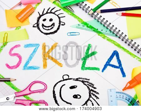 A colorful drawing with Polish word 'school' and school accessories