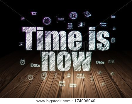 Time concept: Glowing text Time is Now,  Hand Drawing Time Icons in grunge dark room with Wooden Floor, black background