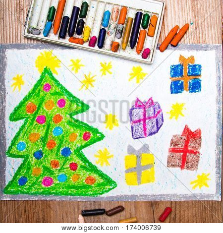 colorful drawing and crayons: Christmas tree and gifts