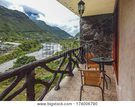 Balcony room with beatiful view of wet or rainy forest landscape at Banos a touristic destination located in Ecuador.