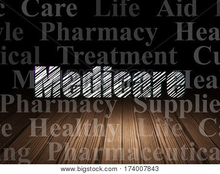 Healthcare concept: Glowing text Medicare in grunge dark room with Wooden Floor, black background with  Tag Cloud