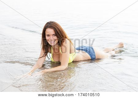 Young Sexy Woman In A Swimsuit In The Sea Water