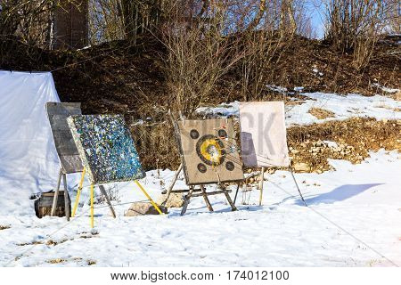 Target pierced with arrows. Homemade projectile for target shooting stands in snow. National sports entertainment outdoors. Hit target as success of business & Affairs. Funny Nicholas Fortress Russia