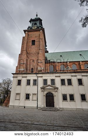 Towers of the gothic cathedral during autumn in Gniezno