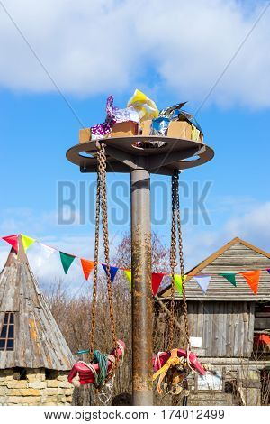 Shrovetide festivities pancake week. Competitive gifts for the participants of the festival on a high post. Mardi Gras celebration outdoors in Funny Nicholas Fortress