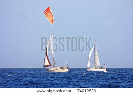 Yachts and kitesurfer sailing off Vancouver Island