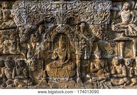 Bas-relief in Borobudur Buddist Temple - island Java Indonesia - architecture background