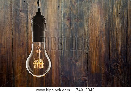 Vintage Incandescent Edison Type Bulb On Wooden Background