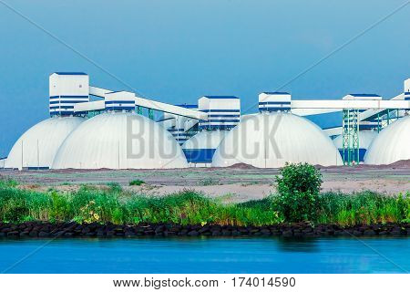 Riga fertilizer terminal with saltpeter against river coast