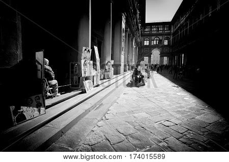 Florence Italy - February 25 2017:Caricaturists waiting for the tourists in front of the entrance to the famous Uffizi museum