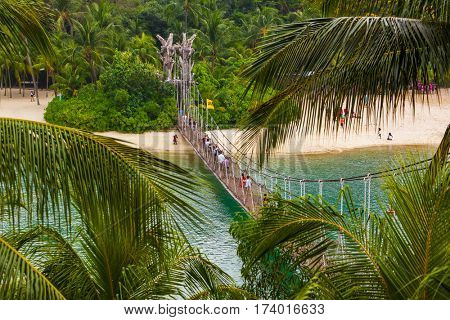 Hanging bridge to Palawan island in Sentosa Singapore - travel background
