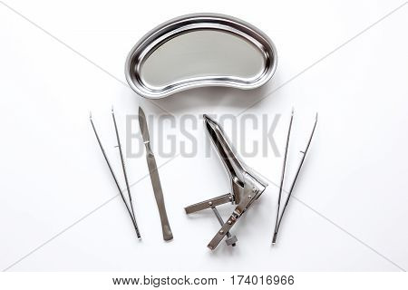 instruments of gynecologist on white background top view.