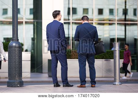 London, UK - 8 September, 2016: Business people walking on the Canary Wharf square, business and financial aria. Modern life concept