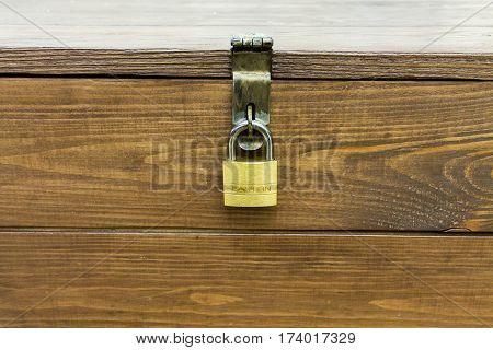 Closed lock on the box. Padlock. Cache property.