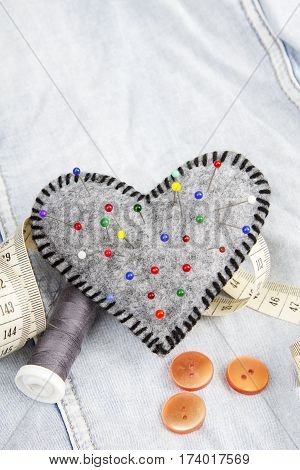 Heart shaped pincushion and tailor accessories , copy space