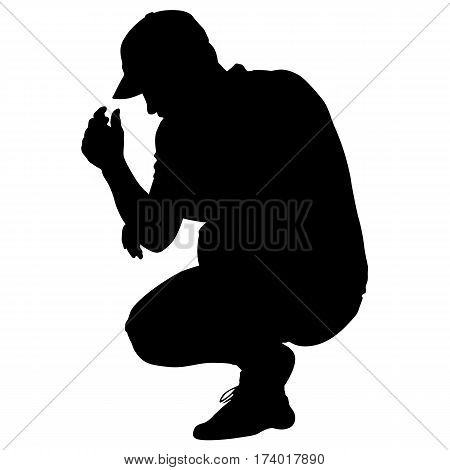 Black silhouettes man sitting on his haunches. Vector illustration.