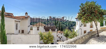 Panoramic view of the Alhambra. The Arabian quarter Albaicin and the view of the world famous Alhambra in Granada.