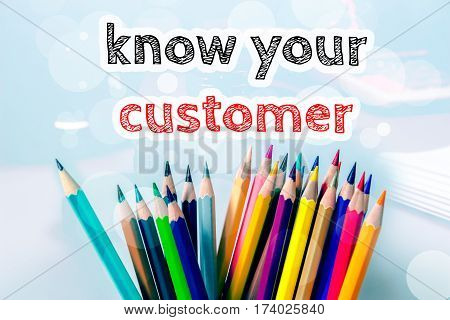 Know your customer, text message on blue background with color pencil