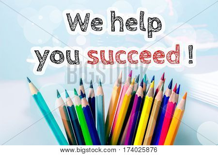 We help you succeed, text message on blue background with color pencil