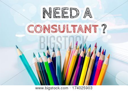 Need a consultant, text message on blue background with color pencil