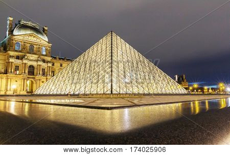 PARIS, FRANCE - February 27: Louvre pyramid closeup view in Paris. With over 60k sqM of exhibition space, Louvre is the biggest Museum in Paris.