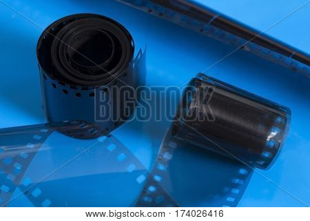Vintage film strip rolls on blue background
