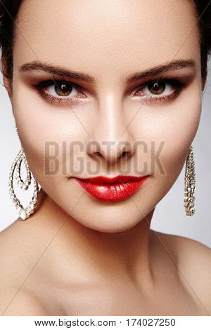 Beautiful Happy Woman In Luxury Fashion Earrings. Diamond Shiny Jewelry With Brilliants. Sexy Retro