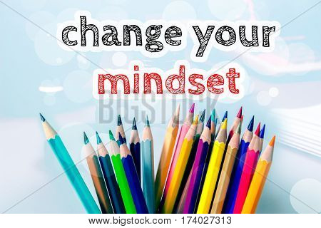 Change your mindset, text message on blue background with color pencil