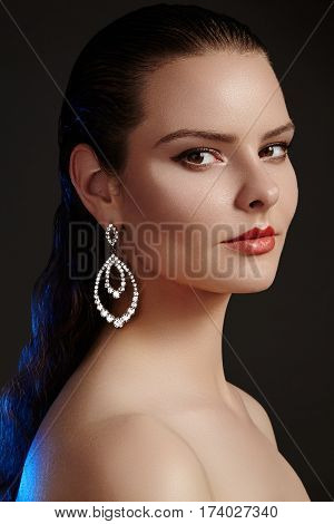 Beautiful Woman In Luxury Fashion Earrings. Diamond Shiny Jewelry With Brilliants. Accessories Jewel