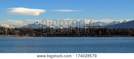 View across Lake Geneva (Lac_Leman) in Geneva, Switzerland. In the distance is Mont_Blanc and others in the Alps.