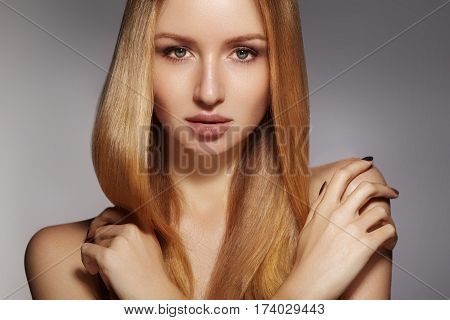 Fashion long hair. Beautiful blond girl. Healthy straight shiny hair style. Beauty woman model. Shine smooth hairstyle