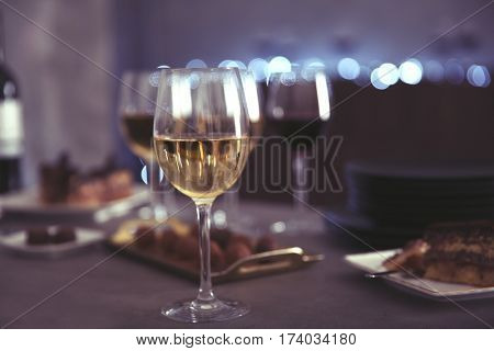 Wine and delicious chocolate desserts on table