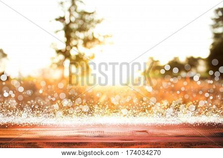 empty wooden on golden nature lighting backdrop. christmas light background. Wood table top. can used for display or montage your products