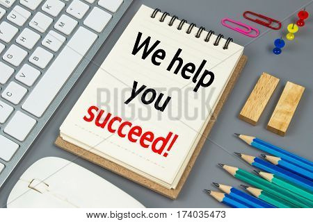 We help you succeed, Text message on white paper