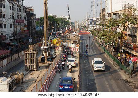 BTS Sky train green line under construction the center at Kaset intersection Bangkok Thailand Traffic has special way at right. Amornphant market and Kasetsart University2017Mar1 on 4:04 P.M