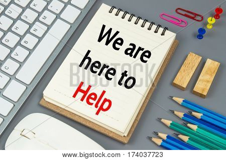 We are here to help, Text message on white paper