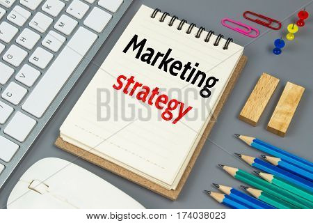 Marketing strategy, Text message on white paper
