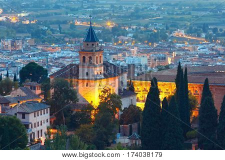 Iglesia de Santa Maria in palace and fortress complex Alhambra during evening blue hour in Granada, Andalusia, Spain