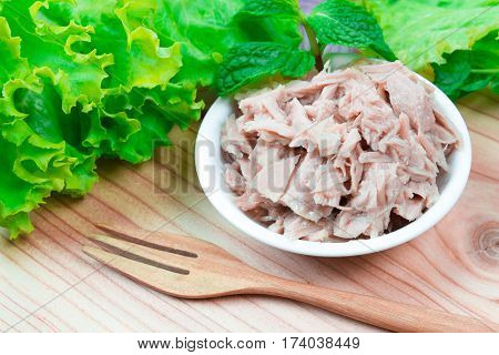 tuna on wood table / cup albacore pink meat tuna packed in water