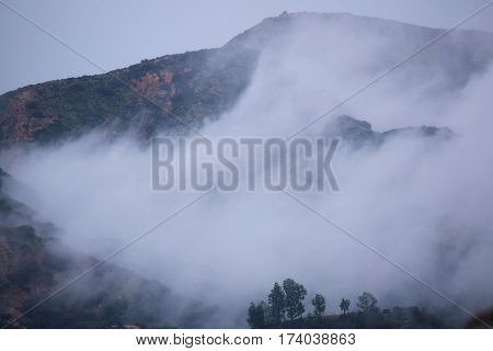 Mountains surrounded by fog taken during the rain at the San Gabriel Mountain Foothills in Claremont, CA