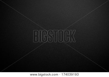 Black texture background with spotlight. Dark tone