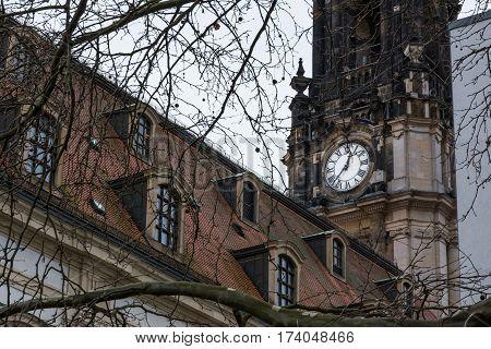 Clocktower Closeup Church White Roman Numerals Stone Architecture Religion Winter Cold Day Tree Branches