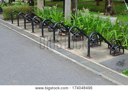 Empty outdoor bicycle parking lot in public garden