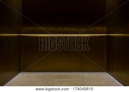 Empty Fancy Elevator Carriage Metal Pole Inside Metal Box Interior Closed Elegant Gold Bronze Overhe