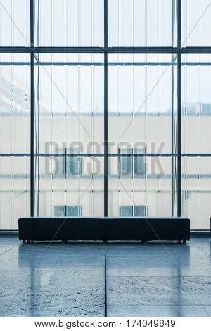 Indoor Rectangular Bench In Front Of Glass Wall Cold Blue Atmosphere Art Gallery Quiet Room Alone