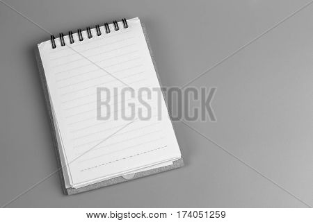 white paper note on gray background. white paper book