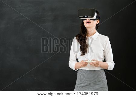 Asian Teacher Touch Screen With Vr Headset Smartphone