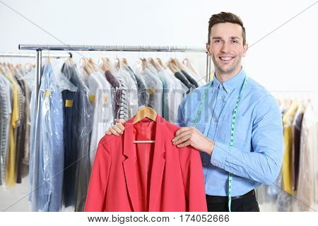 Male worker in dry-cleaning salon