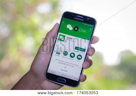 Chiang Mai,Thailand - March 2, 2017: Smartphone Samsung Galaxy S6 open apps wechat application on the screen on the desk.